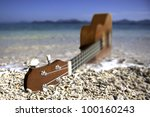ukulele on a beach   Shutterstock . vector #100160243