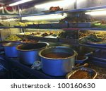 PENANG, MALAYSIA-APRIL 13:Variety of spicy dishes for 'nasi kandar' or 'kandar rice' in Penang, Malaysia on April 13, 2012. Nasi kandar is a popular spicy dish originating from Penang Indian Muslim - stock photo