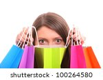A picture of a young happy woman among shopping bags over white background - stock photo