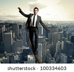 businessman is balancing on a... | Shutterstock . vector #100334603