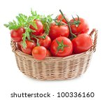 Fresh red tomatoes in a basket on a white background - stock photo