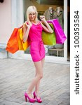 Blonde girl shopping - stock photo