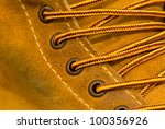 yellow adventure boots close-up - stock photo