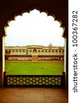 view of lawn through doorway at agra fort - stock photo