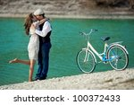 Beautiful young couple kissing and hugging on the coast - stock photo