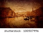 Gloomy textured image of Grand Canal and Rialto Bridge in Venice. - stock photo