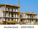 Houses on a construction site - stock photo