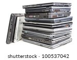 Pile of used laptops, white background - stock photo