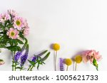 composition from fresh flowers... | Shutterstock . vector #1005621733