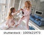 feeling playful. top view of... | Shutterstock . vector #1005621973