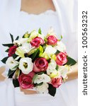 Bride holding beautiful wedding bouquet - stock photo