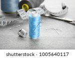 spool of sewing thread with... | Shutterstock . vector #1005640117
