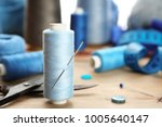 spool of sewing thread with... | Shutterstock . vector #1005640147