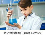 little child with learning... | Shutterstock . vector #1005669403