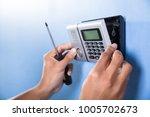 human hand installing security... | Shutterstock . vector #1005702673