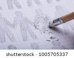Stock photo close up of pencil eraser erasing drawn figures on paper 1005705337