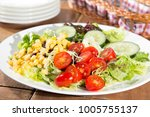 fresh healthy salad | Shutterstock . vector #1005755137