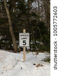 Small photo of Sign to let drivers know the speed limit is 5 miles per hour.