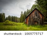 an old barn sits on the edge of ... | Shutterstock . vector #1005775717