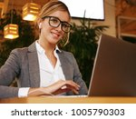 businesswoman working on laptop ... | Shutterstock . vector #1005790303