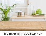 table top with blurred kitchen... | Shutterstock . vector #1005824437
