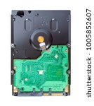 Small photo of Top view of a hard drive isolated on a white background. Computer hardware