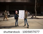 Small photo of 3rd grade feminists. Equal pay. Los Angeles, California, United States-January 20, 2018: Women's March showed the liberal people speaking out with signs against Donald Trump & speaks about minorities.