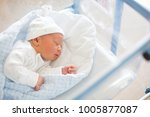 beautiful newborn baby boy ... | Shutterstock . vector #1005877087