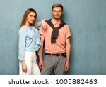 fashion girl and guy in outlet... | Shutterstock . vector #1005882463