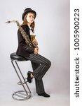 girl playing saxophone | Shutterstock . vector #1005900223