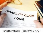 man holding disability claim... | Shutterstock . vector #1005919777