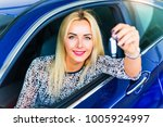 happy young woman driver... | Shutterstock . vector #1005924997