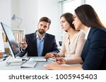 business people working with... | Shutterstock . vector #1005945403