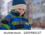 portrait of a european boy with ... | Shutterstock . vector #1005980137