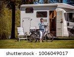 woman on electric bike resting...   Shutterstock . vector #1006049017