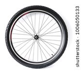 Small photo of Black and alloy bicycle wheel isolated on white background
