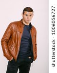 brutal man in a leather jacket... | Shutterstock . vector #1006056727