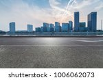 empty road with modern business ... | Shutterstock . vector #1006062073