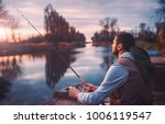 fisherman angling on the river. ... | Shutterstock . vector #1006119547