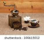 Coffee grinder and coffee - stock photo