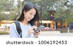 woman use of mobile phone at... | Shutterstock . vector #1006192453
