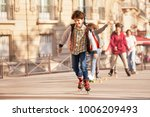 happy teenage boy roller... | Shutterstock . vector #1006209493