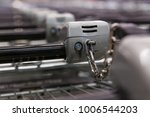 many empty shopping carts in a... | Shutterstock . vector #1006544203
