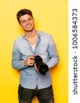 widely smiling man standing...   Shutterstock . vector #1006584373