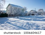 winter street in the snow  a... | Shutterstock . vector #1006604617