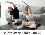 sporty young couple warming up... | Shutterstock . vector #1006618393