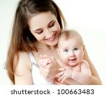 happy mother with baby | Shutterstock . vector #100663483