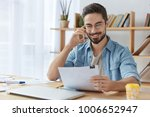 happy young unexperienced male... | Shutterstock . vector #1006652947