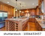 gourmet kitchen boasts a bar... | Shutterstock . vector #1006653457
