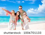 young family on vacation have a ... | Shutterstock . vector #1006701133